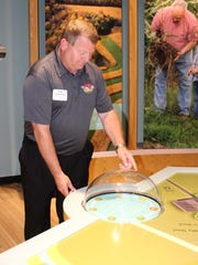 UW-Extension Agent Scott Gunderson of Manitowoc County checks out one of the interactive displays at the Farm Wisconsin Discovery Center.