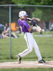 Plymouth Christian's Adam Albert barrels up a pitch