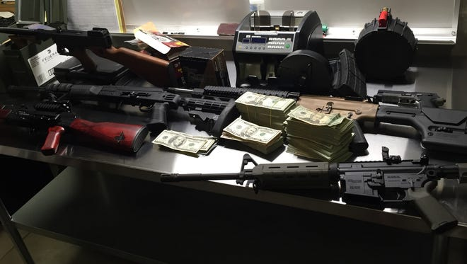 Drugs, guns and money were seized in a Shelby County drug investigation.