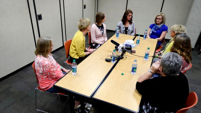 Sen. Tammy Baldwin, second from left, holds a roundtable with women affected by substance abuse, either as mothers whose children struggle with addiction or have died, or who are going through recovery themselves Tuesday at the Appleton Public Library in Appleton.