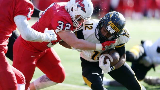 Manalapan's Sal Tardogno stops Piscataway's Juwon  Jackson in Central Group V sectional football championship at Rutgers University's High Point Solutions Stadium. Piscataway won the game 34-13. Dec. 3, 2016, Piscataway, NJ.