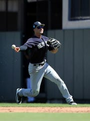 New York Yankees infielder Tyler Wade (39) throws the ball to first base for an out during the third inning against the Detroit Tigers at Publix Field at Joker Marchant Stadium.