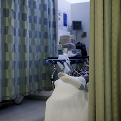 A patient waits in the emergency room of Cooper University