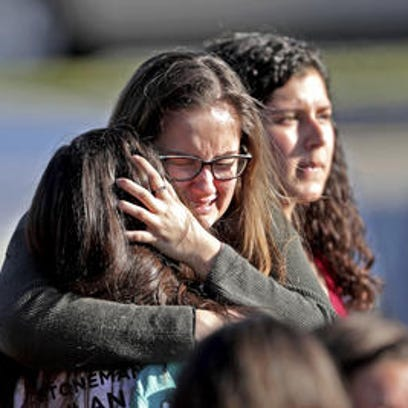 Students embrace after a mass shooting at Marjory Stoneman