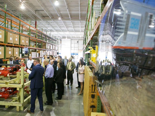 Guests get a tour of Siemens' new East Coast Locomotive Service Hub, a 40,000-square-foot facility near New Castle.