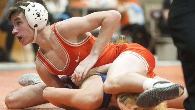 Cherokee 106-pound wrestler Andrew Aromando, top, controls action in a bout on Jan. 3 against Eastern.