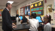 Principal Frank Hendricsen works with students using