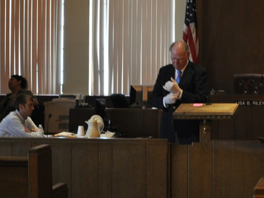 Defense attorney Kenneth Wilson, right, prepares to