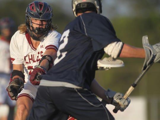 Chiles defenseman Nic McEwey pokes his long stick at