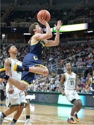 Clarkston junior guard Foster Loyer goes up for a shot