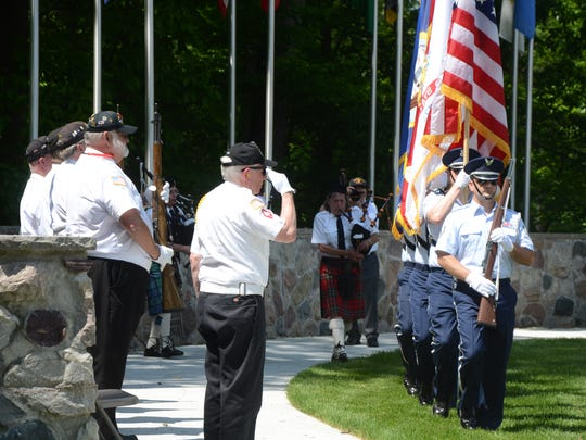 Members of the Fort Custer National Cemetery Honor Guard salute as the program ends.