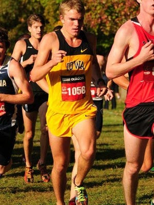Kevin Lewis, competing in cross country at Iowa.