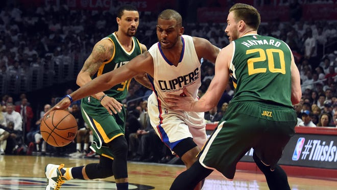 April 25, 2017; Los Angeles, CA, USA; Los Angeles Clippers guard Chris Paul (3) moves the ball against Utah Jazz forward Gordon Hayward (20) during the first half in game five of the first round of the 2017 NBA Playoffs at Staples Center.