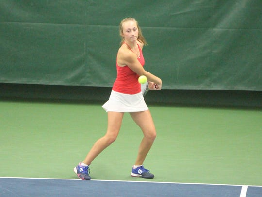 Grace Cady readies for a backhand as she and doubles partner Meaghan Esser battle Homestead on Oct. 13 at the state tennis meet.