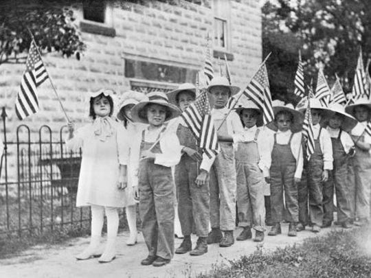 Children of the Andrew D. Gwynne Institute celebrate George Washington's birthday. The school opened in 1911.