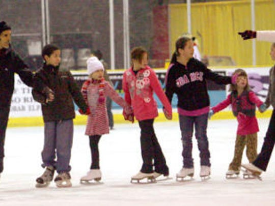 People ice skate at the El Paso County Coliseum.