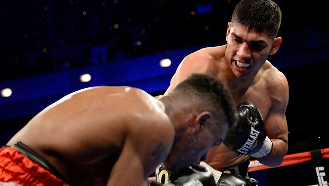 Antonio Orozco, top, knocks down Keandre Gibson with a right hand Saturday night.