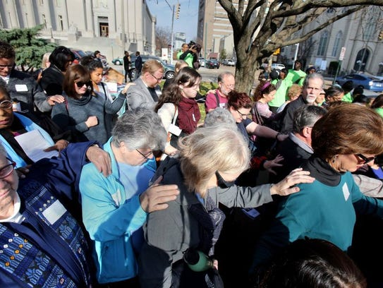 Memphis area residents take part in a prayer service