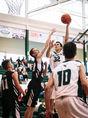 Williamston sophomore Sean Cobb drops in two from the paint Wednesday, Dec. 21, 2016, against Dansville at Williamston.