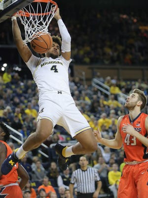 Michigan forward Isaiah Livers dunks against Illinois in the first half Saturday in Ann Arbor.