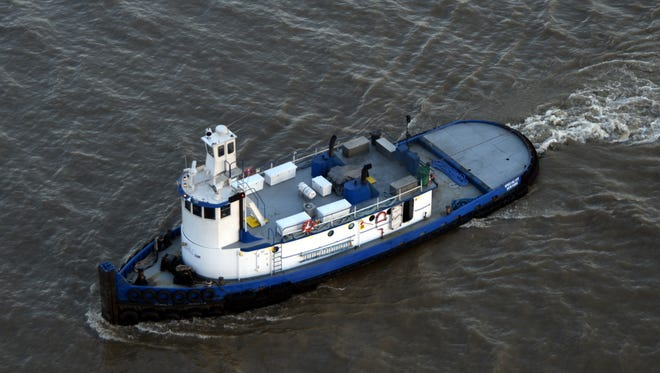 The tug boat Specialist is seen on March 9, 2016 heading up-river. Specialist crashed before 5:30 a.m. Saturday morning. One crew member has been confirmed dead.