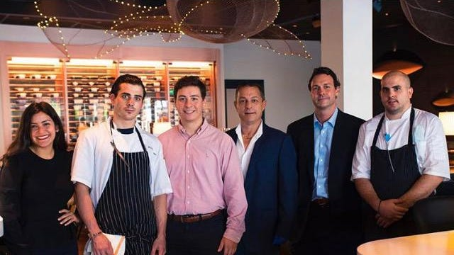 Copperfish Kitchen owner George Anagnostou, third from right, and his team.
