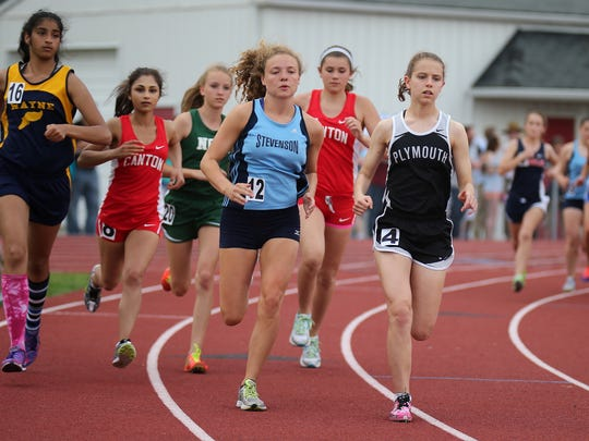 Coming around the bend at Livonia Churchill Friday is this group of runners during the conference meet.