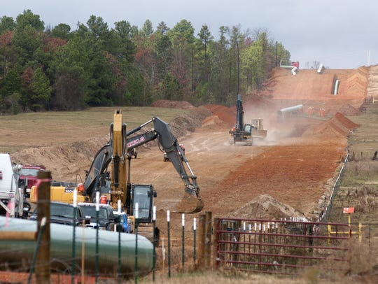 In this Dec. 3, 2012 file photo, crews work on construction