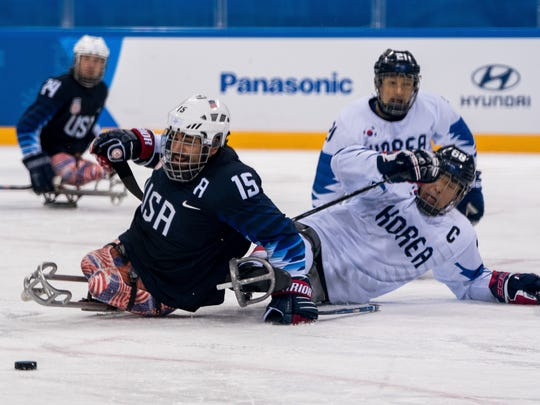 Nikko Landeros of the USA and Min Su Han KOR collide while battling for the puck during a Paralympic Winter Games  preliminary round game between the U.S. and Korea at the Gangneung Hockey Centre on Tuesday. Landeros lives in Johnstown.
