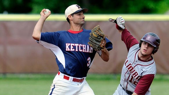Elmira High School's Calvin Blish is forced out at second base as Roy C. Ketcham High School's Mark Joao throws to first on Friday in Freedom Plains.