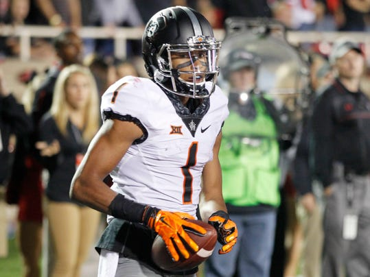 Oklahoma State wide receiver Jalen McCleskey makes a second quarter touchdown catch against Texas Tech in an NCAA college football game Saturday, Sept. 30, 2017, in Lubbock, Texas. (Mark Rogers/Lubbock Avalanche-Journal via AP)