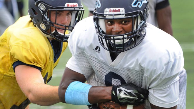 Wesley running back Jamar Baynard runs the ball during practice on Friday. Baynard is a Middletown graduate and the Wolverines' top returning rusher.