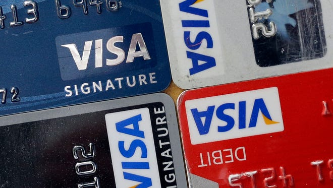 Credit and debit cards are displayed for a photographer in Baltimore.