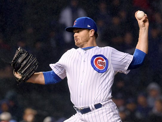 Cubs reliever Justin Wilson pitches in the ninth inning