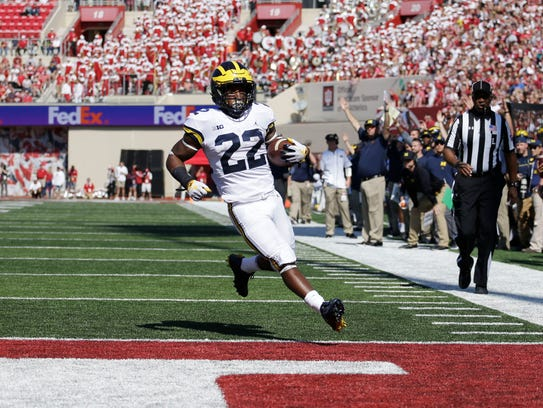 Michigan running back Karan Higdon rushed for 200 yards and three touchdowns on Saturday against Indiana.