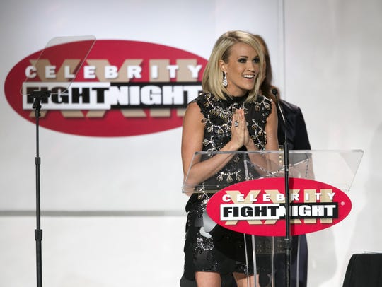 Musician Carrie Underwood accepts an award during Celebrity