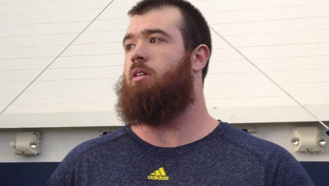 """Offensive tackle Erik Magnuson said the Wolverines are all football. """"Our main goal is to win this game, so I think we're doing it a little bit different than other teams."""""""