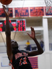 Northeastern's Kobi Nwandu puts up a shot during Wednesday's game at William Penn Senior High School. Nwandu is an all-around contributor for the Bobcats, averaging nearly 16 points per game.