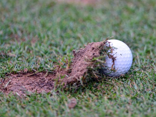 It's a common problem to hit the ground before the ball, causing a divot.