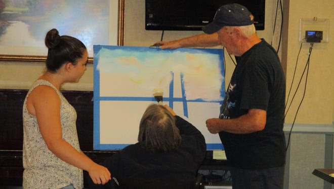 Heather Hommel, Jean Williams and Chuck Williamson participate in the 'Creating a Masterpiece with Chuck' program at Susquehanna Nursing & Rehabilitation Center.