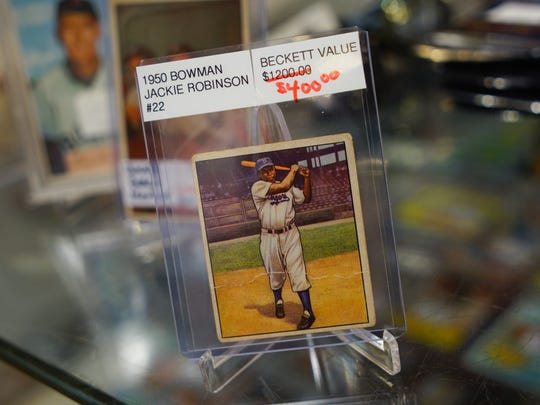 A rare 1950 Jackie Robinson baseball card sold by Scott Polsen  AB Sports at Concord Mall.