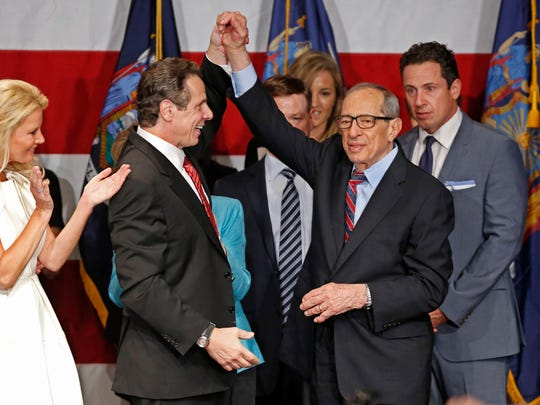 Democratic New York Gov. Andrew Cuomo celebrates with his father, former New York governor Mario Cuomo, after defeating Republican challenger Rob Astorino at Democratic election headquarters in New York on Nov. 4, 2014.