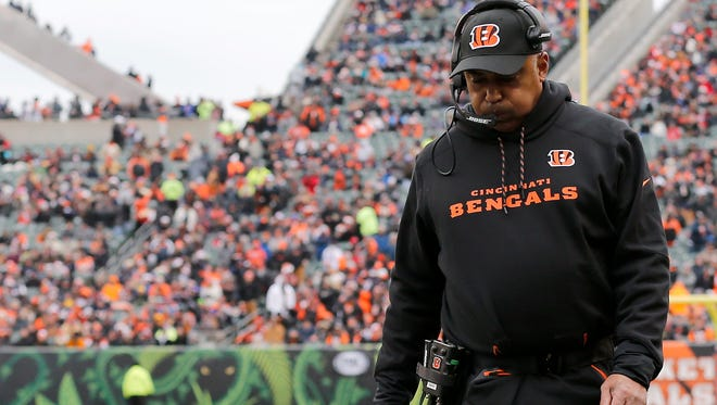 Cincinnati Bengals head coach Marvin Lewis paces the sideline in the first quarter of the NFL Week 14 game between the Cincinnati Bengals and the Chicago Bears at Paul Brown Stadium in downtown Cincinnati on Sunday, Dec. 10, 2017. At halftime the Bears led 12-7.