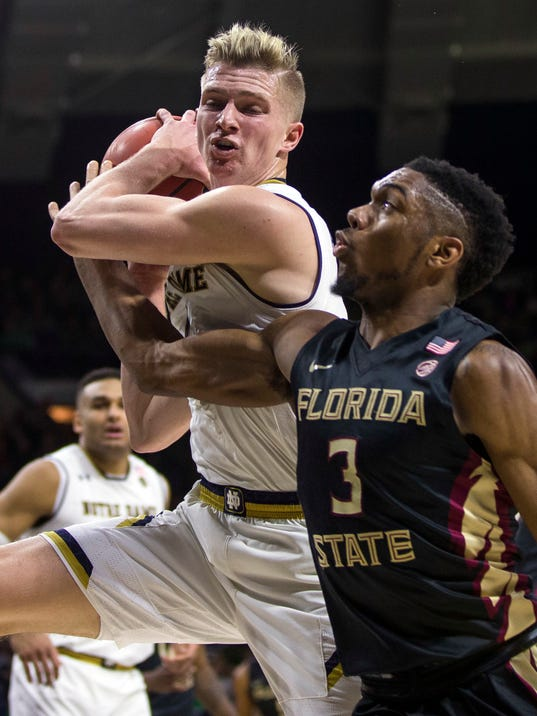 Notre Dame's Rex Pflueger, left, grabs a loose ball next to Florida State's Trent Forrest (3) during the first half of an NCAA college basketball game Saturday, Feb. 10, 2018, in South Bend, Ind. (AP Photo/Robert Franklin)