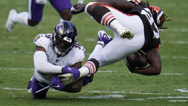 Baltimore Ravens safety Chuck Clark (36) grabs Cleveland Browns running back Kareem Hunt's (27) foot, during the second half of an NFL football game, Sunday, Sept. 13, 2020, in Baltimore, MD.