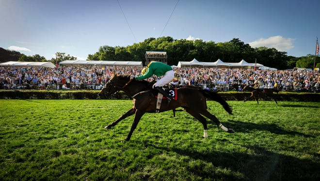 Jack Doyle and Rawnaq cross the finish line winning the Calvin Houghland Iroquois during the 75th Iroquois Steeplechase at Percy Warner Park, Saturday, May 14, 2016, in Nashville, Tenn.
