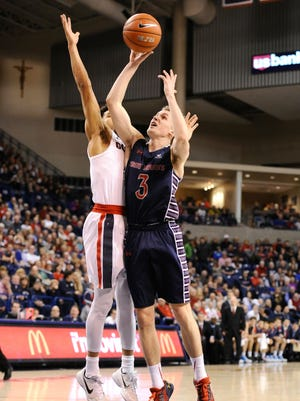 Saint Mary's Gaels guard Emmett Naar (3) goes up for a shot against Gonzaga Bulldogs guard Silas Melson (0) during the first half at McCarthey Athletic Center.