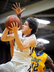 Webster County's Daylan Lewis (14) shoots past Caldwell County's Russel Brandon (42) during their game at Webster County High School in Dixon, Thursday, Dec. 15, 2016.