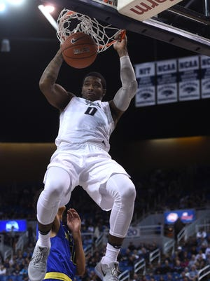 Nevada's Cameron Oliver dunks during the Wolf Pack's win over San Jose State on Wednesday.