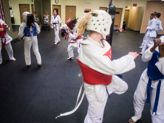 Students practice gyroogi, olympic style sparring,